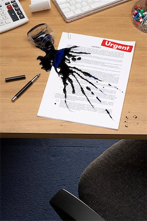 Spilt ink on document on desk, elevated view Stock Photo - Premium Royalty-Free, Code: 618-01639330