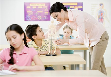 pre-teen boy models - Teacher showing model skeleton to boy (10-11) in classroom Stock Photo - Premium Royalty-Free, Code: 618-01693871