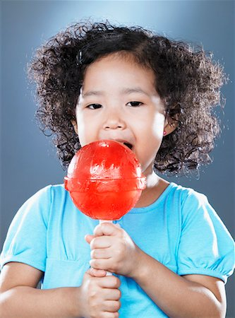 red lollipop - Girl (2-4) licking oversized lollipop Stock Photo - Premium Royalty-Free, Code: 618-01737703