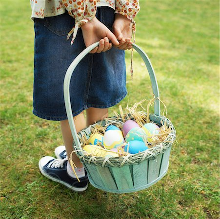 Boy (10-11) holding basket of eggs on lawn, low section Stock Photo - Premium Royalty-Free, Code: 618-01738903