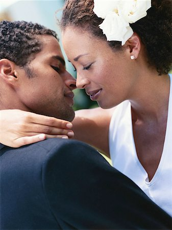 Newlywed couple about to kiss, close-up Stock Photo - Premium Royalty-Free, Code: 618-01885508