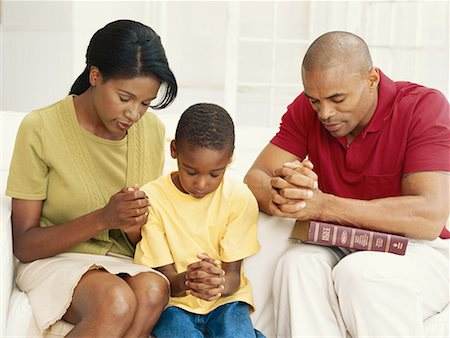 Parents with son (6-9) praying Stock Photo - Premium Royalty-Free, Code: 618-01887012