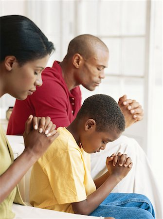 Parents with son (6-9) praying, side view Stock Photo - Premium Royalty-Free, Code: 618-01887013
