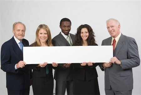 Group portrait of business people holding blank banner Stock Photo - Premium Royalty-Free, Code: 618-01887115