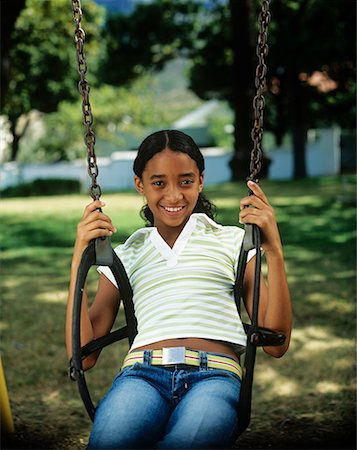 preteen  smile  one  alone - Girl (12-13) on swing in park, smiling,portrait Stock Photo - Premium Royalty-Free, Code: 618-01882922