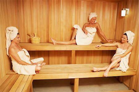 Three mature women wearing towels sitting in a sauna Stock Photo - Premium Royalty-Free, Code: 618-03570797