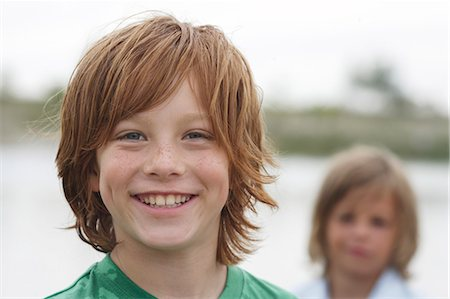 Portrait of happy young boy with red hair Stock Photo - Premium Royalty-Free, Code: 618-03571404