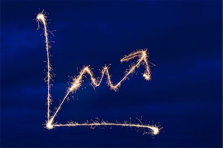 fireworks colored picture - Lit up sparkler in arrow shape with blue sky background Stock Photo - Premium Royalty-Free, Code: 618-03571438