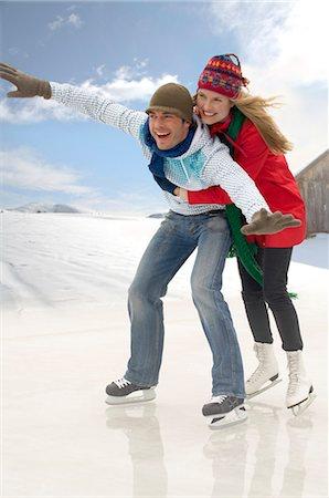 Couple ice skating Stock Photo - Premium Royalty-Free, Code: 618-03571685