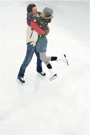 Couple ice skating Stock Photo - Premium Royalty-Free, Code: 618-03571756