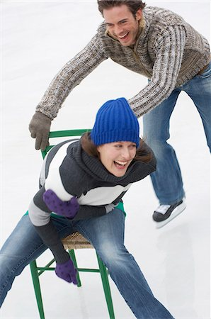 Couple playing in ice rink Stock Photo - Premium Royalty-Free, Code: 618-03571796