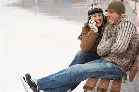 Couple sitting on bench at ice rink Stock Photo - Premium Royalty-Free, Code: 618-03571800