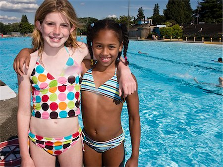 2 girls portrait by pool side Stock Photo - Premium Royalty-Free, Code: 618-03571922