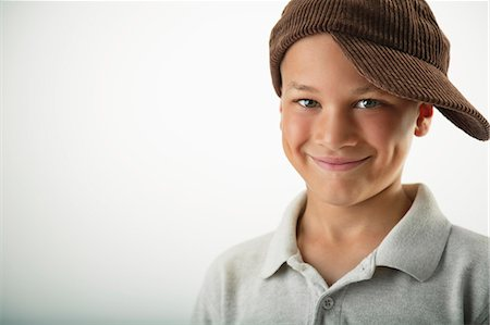 boy with dimples wearing a hat sideways Stock Photo - Premium Royalty-Free, Code: 618-03573240