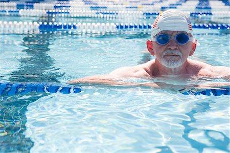 seniors and swim cap - Elderly man in lap pool Stock Photo - Premium Royalty-Free, Code: 618-03608102
