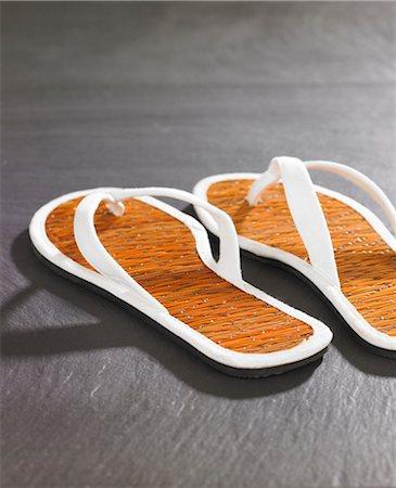 slate - flip-flops on slate Stock Photo - Premium Royalty-Free, Code: 618-03608452
