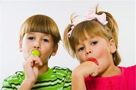 picture of a red lollipop - Boy and girl  enjoying green and red lollipops Stock Photo - Premium Royalty-Free, Code: 618-03610031