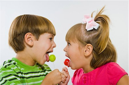 picture of a red lollipop - Boy and girl enjoying green and red lollipops Stock Photo - Premium Royalty-Free, Code: 618-03610050