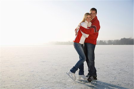 Portrait of couple embracing on ice, smiling Stock Photo - Premium Royalty-Free, Code: 618-03611006