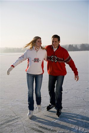 Couple ice skating together, front view Stock Photo - Premium Royalty-Free, Code: 618-03611003