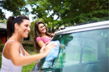 Mother daughter washing car Stock Photo - Premium Royalty-Free, Code: 618-03612176