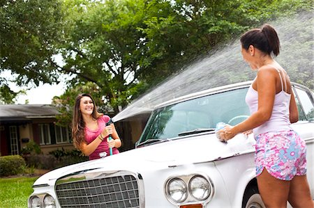 Mother daughter washing car Stock Photo - Premium Royalty-Free, Code: 618-03612184