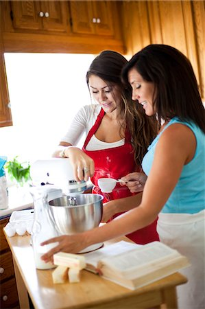 Mother daughter in kitchen Stock Photo - Premium Royalty-Free, Code: 618-03612190
