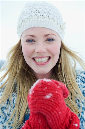A portrait of a young woman wearing a woolen hat and red gloves Stock Photo - Premium Royalty-Free, Code: 618-03612579