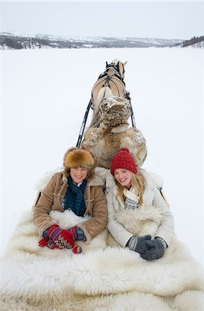 Two women riding on a sleigh Stock Photo - Premium Royalty-Free, Code: 618-03612658