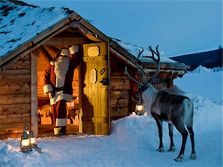reindeer in snow - Santa Claus standing in the doorway of a log cabin Stock Photo - Premium Royalty-Free, Code: 618-03612689