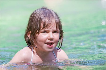 A young girl swimming Stock Photo - Premium Royalty-Free, Code: 618-03612885