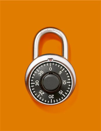 Combination lock or padlock closed and alone Stock Photo - Premium Royalty-Free, Code: 618-03630496