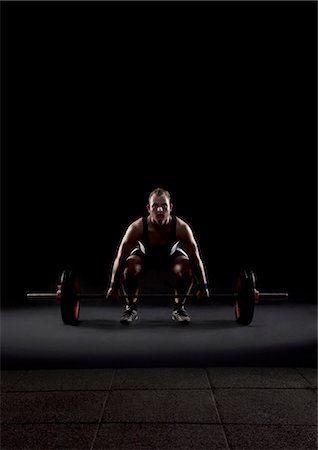 fat man exercising - Weightlifter preparing to lift weight Stock Photo - Premium Royalty-Free, Code: 618-03630690