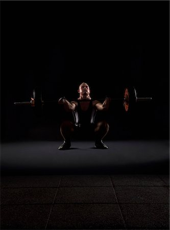 fat man exercising - Weigthlifter beginnig to lift weight Stock Photo - Premium Royalty-Free, Code: 618-03630691