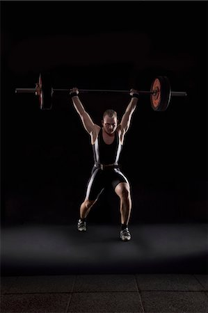 fat man exercising - Weightlifter with heavy weight Stock Photo - Premium Royalty-Free, Code: 618-03630692