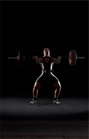 fat man exercising - Weightlifter jerking weight Stock Photo - Premium Royalty-Free, Code: 618-03630693