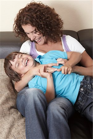Mother tickling boy Stock Photo - Premium Royalty-Free, Code: 618-03631227