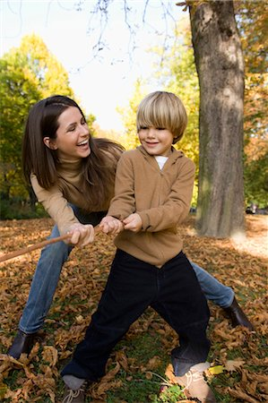 Mother and son playing tug-of-war Stock Photo - Premium Royalty-Free, Code: 618-03631571