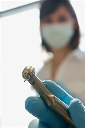 Dentist holding tooth drill in dentist's office Stock Photo - Premium Royalty-Free, Code: 618-03631989