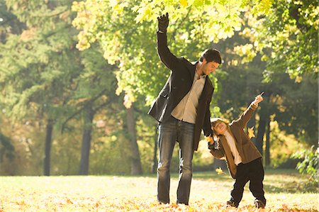 Father and son walking in park in autumn Stock Photo - Premium Royalty-Free, Code: 618-03632254