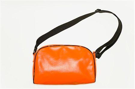 An orange shoulder bag Stock Photo - Premium Royalty-Free, Code: 618-03632593