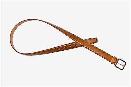 brown men's belt Stock Photo - Premium Royalty-Free, Code: 618-03632626