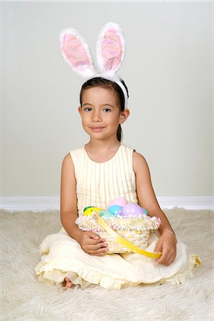 Young girl (4-5) in easter bunny costume, portrait Stock Photo - Premium Royalty-Free, Code: 618-03644227