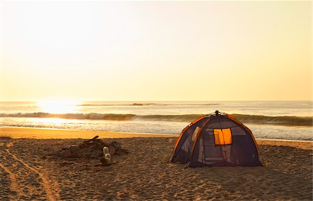 Tent and Burned out Campfire on the Beach. Stock Photo - Premium Royalty-Free, Code: 618-03757106