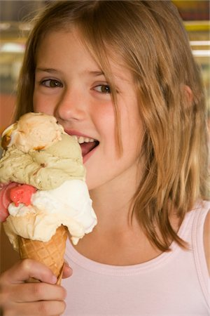 preteen girl licking - A young girl eating an ice cream Stock Photo - Premium Royalty-Free, Code: 618-03757161