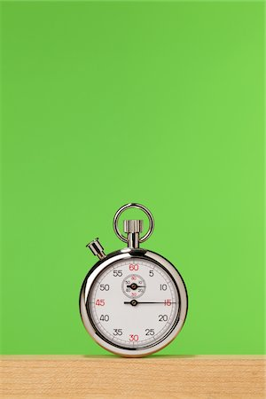 stop watch - Pocket stopwatch on green Stock Photo - Premium Royalty-Free, Code: 618-03757724