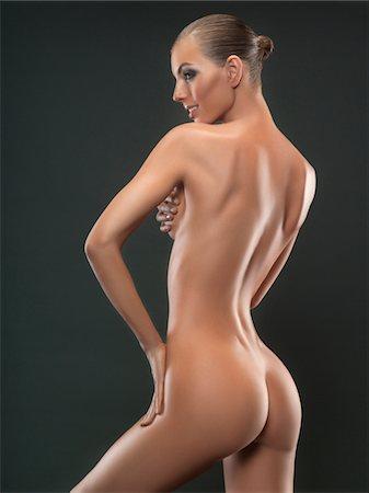 Portrait of young nude woman, studio shot Stock Photo - Premium Royalty-Free, Code: 618-03780547