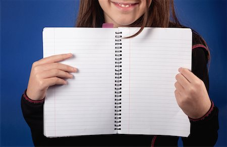 showing - Girl with blank notebook Stock Photo - Premium Royalty-Free, Code: 618-03834514