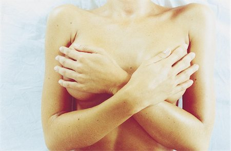 naked woman hiding her breast Stock Photo - Premium Royalty-Free, Code: 610-00798824