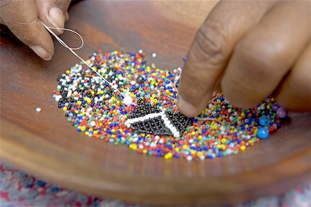 South Africa, Zululand, near Santa Lucia Park, Zulu craft center, making of beads jewels Stock Photo - Premium Royalty-Free, Code: 610-02000179